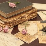 635886685768652338-1889057963_vintage_books_old_flowers_roses_candles_candle_holders_letters_cards_paper_table_74949_4752x2808